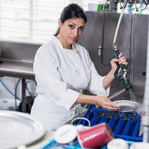 Photo of a female dishwasher working in a restaurant