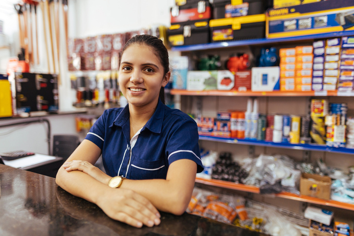 Young woman cashier in a hardware store